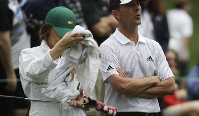 Mike Weir reacts as the horn blows to suspend play for weather during the par three competition at the Masters golf tournament Wednesday, April 5, 2017, in Augusta, Ga. (AP Photo/Chris Carlson)