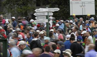 Fans leave Augusta National for a weather warning during a practice round for the Masters golf tournament Wednesday, April 5, 2017, in Augusta, Ga. (AP Photo/David J. Phillip)