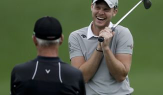Danny Willett, of England, smiles on the driving range during practice round for the Masters golf tournament Monday, April 3, 2017, in Augusta, Ga. (AP Photo/Matt Slocum)