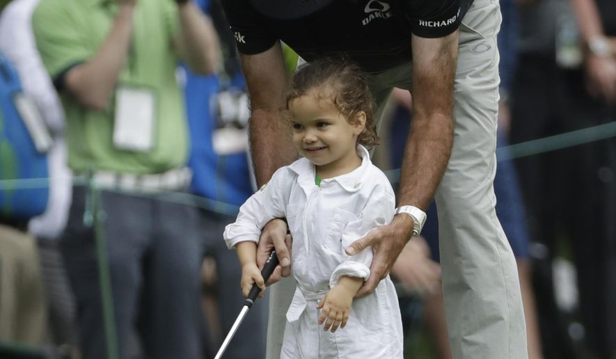 Bubba Watson helps his daughter Dakota putt during the par three competition at the Masters golf tournament Wednesday, April 5, 2017, in Augusta, Ga. (AP Photo/David J. Phillip)