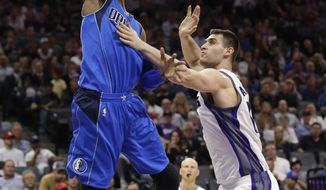 Dallas Mavericks forward Nerlens Noel, left, goes to the basket against Sacramento Kings center Georgios Papagiannis during the first half of an NBA basketball game Tuesday, April 4, 2017, in Sacramento, Calif. (AP Photo/Rich Pedroncelli)