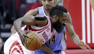 Houston Rockets' James Harden (13) drives into Denver Nuggets' Gary Harris (14) in the first half of an NBA basketball game, Wednesday, April 5, 2017, in Houston. (AP Photo/Michael Wyke)
