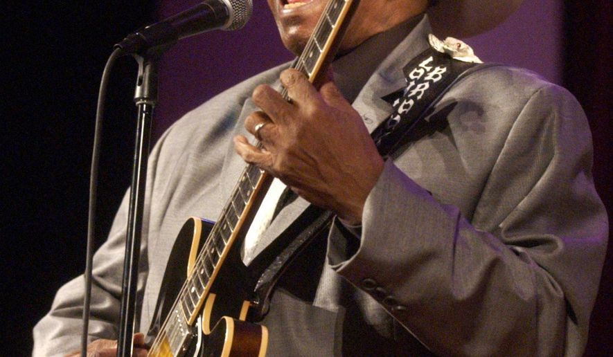 "In this Feb. 13, 2005 photo, guitarist Lonnie Brooks performs with the Chicago Jazz Ensemble at the Simpson Theatre in the Field Museum in Chicago. Brooks, whose relationship with his adopted hometown was cemented by his hit recording of Robert Johnson's ""Sweet Home Chicago,"" has died at age 83. (Terrence Antonio James/Chicago Tribune via AP)"