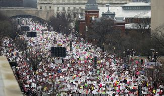 "FILE - In this Jan. 21, 2017, file photo, a crowd fills Independence Avenue during the Women's March on Washington, in Washington. The worldwide women's marches that millions attended the day after President Donald Trump's inauguration are being honored at this year's PEN Literary Gala. PEN America told The Associated Press that ""The Women's March"" is the winner of the PEN/Toni and James C. Goodale Freedom of Expression Courage Award. Bob Bland, one of the national co-chairs who helped organize the massive gathering in Washington, will accept the prize on April 25 in Manhattan. (AP Photo/Alex Brandon, File)"