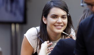 FILE - In this Wednesday, Sept. 14, 2016, file photo, model Kendall Jenner has makeup applied backstage before the Michael Kors Spring 2017 collection is modeled during Fashion Week, in New York. Pepsi is not saying whether it will continue to run an ad, featuring Jenner, that is being widely criticized and mocked on social media for appearing to trivialize protests for social justice causes. (AP Photo/Richard Drew, File)