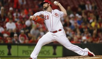 Cincinnati Reds starting pitcher Brandon Finnegan throws during the second inning of the team's baseball game against the Philadelphia Phillies, Wednesday, April 5, 2017, in Cincinnati. (AP Photo/John Minchillo)