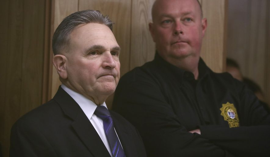 Hudson County Sheriff Frank Schillari, left, looks on during a court proceeding for Michael Hansen, a Hudson County corrections officer, on hit and run charges, Wednesday, April 5, 2017, in Jersey City, N.J. Hansen, who was scheduled to make the appearance via a video conference but could only do it through audio because of technical difficulties, is charged with leaving the scene of an accident in which Jersey City Republican Party Chairman Russell Maffei and Marie Tauro, a prospective legislative candidate, were allegedly struck and killed April 2, 2017, while crossing a street outside a diner in North Bergen, N.J. (AP Photo/Julio Cortez)