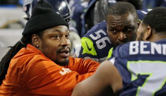 FILE - In this Dec. 4, 2016, file photo, retired Seattle Seahawks running back Marshawn Lynch, left, chats on the sidelines players on the bench in the second half of an NFL football game against the Carolina Panthers in Seattle. Lynch has visited the Oakland Raiders as he decides whether to come back to the NFL and the team decides whether it wants to acquire the hometown favorite. A person familiar with the visit says Lynch came to the facility on Wednesday, April 5, 2017, to meet with Raiders officials. The person spoke on condition of anonymity because the visit wasn't announced by the team. (AP Photo/Ted S. Warren, File) **FILE**