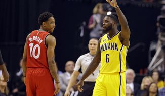Indiana Pacers forward Paul George (13) celebrates as Toronto Raptors guard DeMar DeRozan (10) watches during the second half of an NBA basketball game in Indianapolis, Tuesday, April 4, 2017. The Pacers defeated the Raptors 108-90. (AP Photo/Michael Conroy)