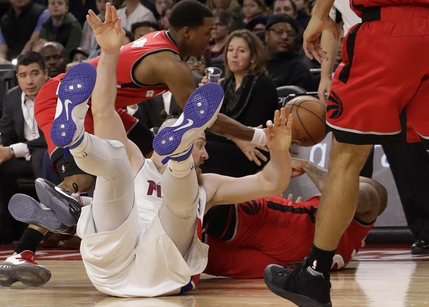 Detroit Pistons center Aron Baynes, left, and Toronto Raptors forward PJ Tucker chase the loose ball during the first half of an NBA basketball game, Wednesday, April 5, 2017, in Auburn Hills, Mich. (AP Photo/Carlos Osorio)