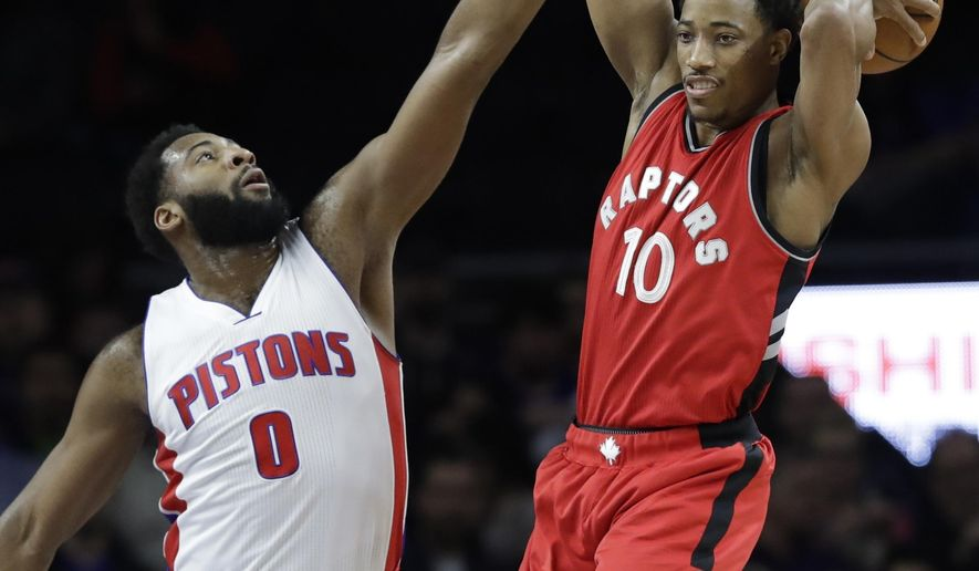 Toronto Raptors guard DeMar DeRozan (10) passes the ball as Detroit Pistons center Andre Drummond (0) defends during the first half of an NBA basketball game, Wednesday, April 5, 2017, in Auburn Hills, Mich. (AP Photo/Carlos Osorio)