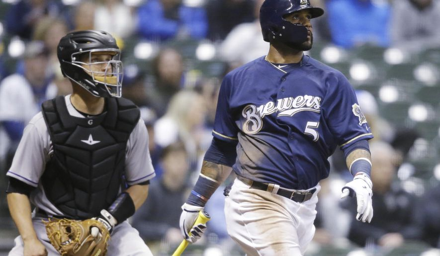 Milwaukee Brewers' Jonathan Villar watches his two-run home run against the Colorado Rockies during the eighth inning of a baseball game Wednesday, April 5, 2017, in Milwaukee. (AP Photo/Jeffrey Phelps)