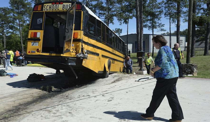 More than 20 Charlton-Pollard Elementary students and one adult were hospitalized when a Beaumont school district bus was involved in a traffic accident on U.S. 69 in Lumberton, Texas, Wednesday, April 5, 2017. The bus was taking several dozen Charlton-Pollard Elementary School students and several adults back to school from a Big Thicket field trip. Officials had no information on how the accident happened, but photos showed the bus veered off the road, through a roadside ditch and into a rock. (Guiseppe Barranco/The Beaumont Enterprise via AP)