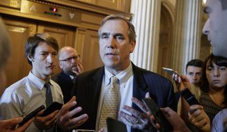 Sen. Jeff Merkley, D-Ore., speaks to reporters just outside the Senate chamber on Capitol Hill in Washington, Wednesday, April 5, 2017. (AP Photo/J. Scott Applewhite) ** FILE **