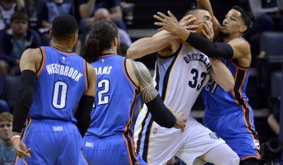 Memphis Grizzlies center Marc Gasol (33) drives against Oklahoma City Thunder guard Russell Westbrook, center Steven Adams, and forward Andre Roberson, from left, during the first half of an NBA basketball game Wednesday, April 5, 2017, in Memphis, Tenn. (AP Photo/Brandon Dill)