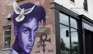 FILE - In this Aug 28, 2016, file photo, a mural honoring the late Prince adorns a building in the Uptown area of Minneapolis. The one-year anniversary of the rock star, who died of an overdose at the age of 57, is April 21. (AP Photo/Jim Mone, File)