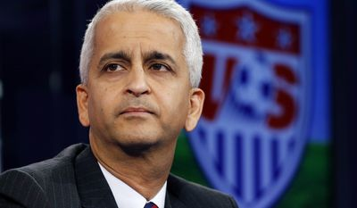 FILE - This Oct. 10, 2014, file photo shows Sunil Gulati, president of the United States Soccer Federation, during a press conference in Bristol, Conn. The U.S. Soccer Federation and the World Cup champion women's team have agreed on a labor contract, settling a dispute in which the players sought equitable wages to their male counterparts. The financial terms and length of the multiyear deal were not disclosed. The agreement was ratified by the players and the federation's board Tuesday, April 4, 2017.  AP Photo/Elise Amendola, File)