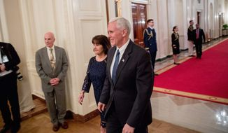 Vice President Mike Pence and his wife Karen arrive for a reception for Senators and their spouses in the East Room of the White House, Tuesday, March 28, 2017, in Washington. (AP Photo/Andrew Harnik)