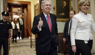 Senate Majority Leader Mitch McConnell of Ky. signals a thumbs-up as he leaves the Senate chamber on Capitol Hill in Washington, Thursday, April 6, 2017, after he led the GOP majority to change Senate rules and lower the vote threshold for Supreme Court nominees from 60 votes to a simple majority in order to advance Neil Gorsuch to a confirmation vote. (AP Photo/J. Scott Applewhite)