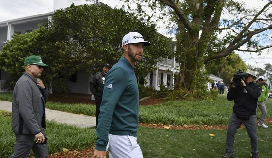 Dustin Johnson walks off the 1st tee after deciding not to play in the opening round of the Masters golf tournament at the Augusta National Golf Club in Augusta, Ga., Thursday, April 6, 2017. The world's No. 1-ranked player was, however, forced to withdraw from the Masters on Thursday because of a lower back injury suffered less than 24 hours earlier in a freak fall at the home he was renting for the week. (Brant Sanderlin/Atlanta Journal-Constitution via AP)
