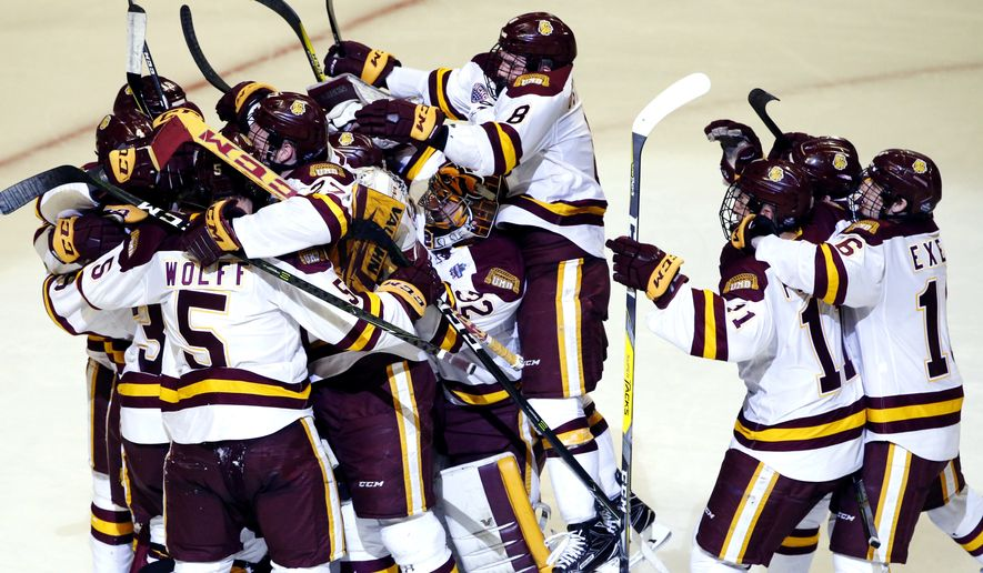 Minnesota-Duluth players celebrate after they defeated Harvard 2-1 during an NCAA Frozen Four men's college hockey semifinal, Thursday, April 6, 2017, in Chicago. (AP Photo/Nam Y. Huh)