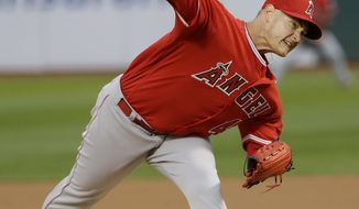 Los Angeles Angels pitcher Garrett Richards (43) throws against the Oakland Athletics during the first inning of a baseball game in Oakland, Calif., Wednesday, April 5, 2017. (AP Photo/Jeff Chiu)