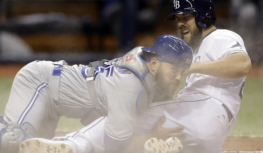 Tampa Bay Rays' Steven Souza Jr., right, gets tagged out by Toronto Blue Jays catcher Russell Martin while trying to score on a fielder's choice by Tim Beckham during the fifth inning of a baseball game Thursday, April 6, 2017, in St. Petersburg, Fla. (AP Photo/Chris O'Meara)