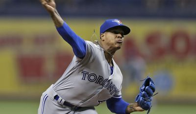 Toronto Blue Jays' Marcus Stroman pitches to the Tampa Bay Rays during the first inning of a baseball game Thursday, April 6, 2017, in St. Petersburg, Fla. (AP Photo/Chris O'Meara)