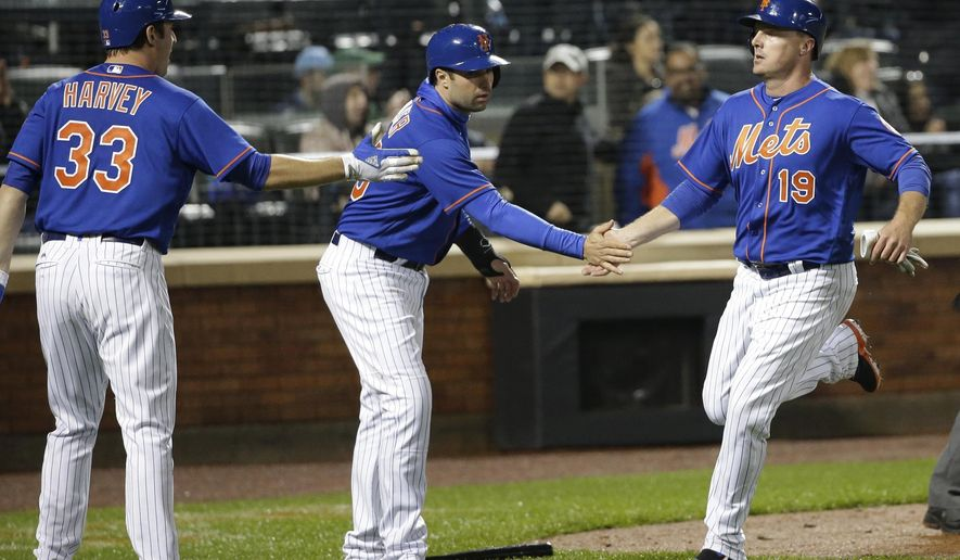 New York Mets' Jay Bruce (19) celebrates with Neil Walker (20) and Curtis Granderson (3) after Bruce and Walker scored on a double by Travis d'Arnaud during the fifth inning of a baseball game against the Atlanta Braves Thursday, April 6, 2017, in New York. (AP Photo/Frank Franklin II)