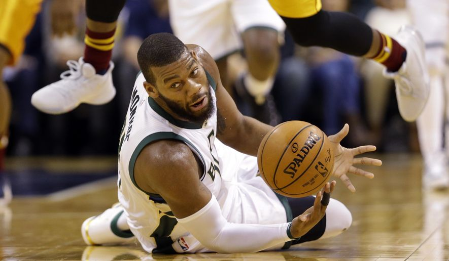 Milwaukee Bucks center Greg Monroe grabs a loose ball on the floor against the Indiana Pacers during the first half of an NBA basketball game in Indianapolis, Thursday, April 6, 2017. (AP Photo/Michael Conroy)