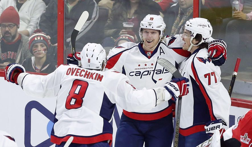FILE- In this Jan. 7, 2017, file photo, Washington Capitals' T.J. Oshie (77) celebrates his goal with teammates Nicklas Backstrom (19) and Alex Ovechkin (8) during the first period of an NHL hockey game against the Ottawa Senators in Ottawa. Oshie has shown to be the perfect complement for Ovechkin and Backstrom and has the potential to be the X-factor for Washington in the playoffs. (Fred Chartrand/The Canadian Press via AP, File)