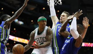 Boston Celtics guard Isaiah Thomas (4) passes as he is defended by Atlanta Hawks forward Thabo Sefolosha (25) in the first half of an NBA basketball game on Thursday, April 6, 2017, in Atlanta. (AP Photo/Todd Kirkland)