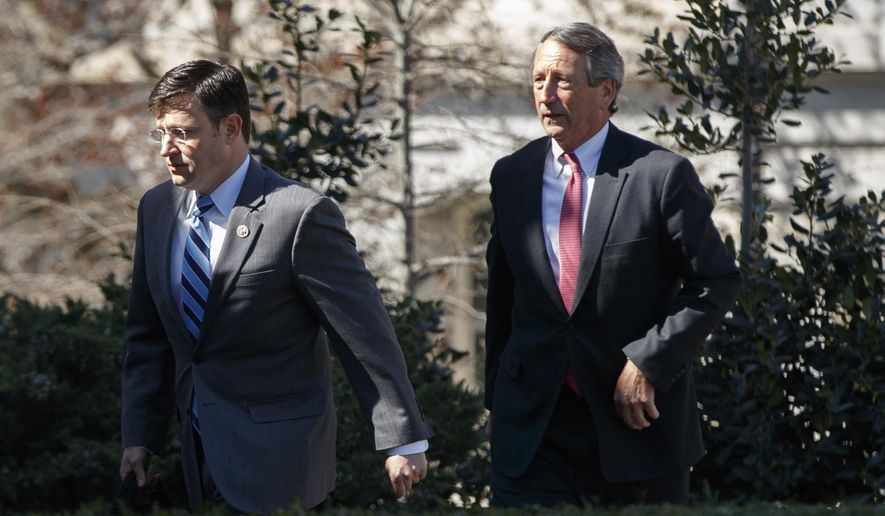In this March 23, 2017, file photo, Rep. Rep. Mike Johnson, R-La., left, followed by House Freedom Caucus member Rep. Mark Sanford, R-S.C., arrives at the White House in Washington. (AP Photo/Evan Vucci, File)
