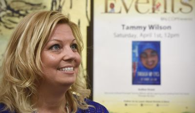 """ADVANCE FOR SATURDAY APRIL 8 AND THEREAFTER - In a Saturday, April 1, 2017 photo, author Tammy Wilson talks about her book, """"Through My Eyes,"""" during an event at Barnes and Noble in St. Cloud, Minn. (Dave Schwarz/The St. Cloud Times via AP)"""