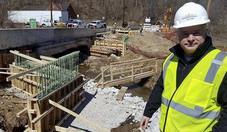 ADVANCE FOR THE WEEKEND OF APRIL 8-9 AND THEREAFTER - In a March 23, 2017 photo, Jeff Rossi, the public information coordinator with Walsh Granite, stands beside a bridge on Route 18 in Holbrook that is being reconstructed as part of Pennsylvania's rapid bridge replacement program. The span over House Run is one of more than 500 structurally deficient bridges across the state that are being replaced over a three-year period through a public-private partnership.  (Mike Jones/Observer-Reporter via AP)