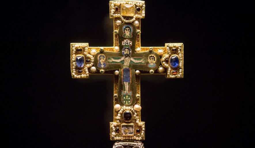 FILE - In this Jan. 9, 2014, file photo, a medieval Cross, part of the Welfenschatz, is displayed at the Bode Museum in Berlin. The heirs of several Nazi-era Jewish art dealers have spent nearly a decade trying to persuade German officials to return the collection of medieval relics valued at more than $250 million. But they didn't make much headway until they filed a lawsuit in an American court. They won a round last week when a federal judge ruled that Germany can be sued in the United States over claims the so-called Guelph Treasure was sold under duress in 1935. ( AP Photo/Markus Schreiber, File)
