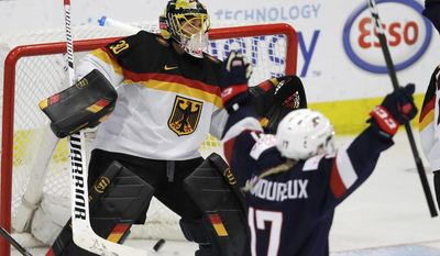 United States forward Jocelyne Lamoureux-Davidson (17) reacts after a goal by teammate Kelli Stack on Germany goalie Jennifer Harss during the first period of a IIHF Women's World Championship semifinal hockey tournament game, Thursday, April 6, 2017, in Plymouth, Mich. (AP Photo/Carlos Osorio)