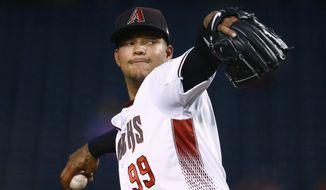 Arizona Diamondbacks' Taijuan Walker throws a pitch against the San Francisco Giants during the second inning of a baseball game Wednesday, April 5, 2017, in Phoenix. (AP Photo/Ross D. Franklin)