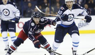 Columbus Blue Jackets' Matt Calvert, left, and Winnipeg Jets' Joel Armia, of Finland, chase a loose puck during the first period of an NHL hockey game Thursday, April 6, 2017, in Columbus, Ohio. (AP Photo/Jay LaPrete)