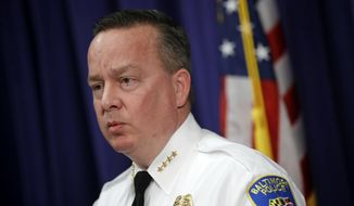 """In this Tuesday, April 4, 2017 photo, Baltimore Police Department Commissioner Kevin Davis speaks at a news conference at the department's headquarters in Baltimore, in response to the Department of Justice's request for a 90-day delay of a hearing on its proposed overhaul of the police department. Hundreds of Baltimore residents are expected to show up to offer commentary, critiques and recommendations regarding a proposed agreement to overhaul the city's troubled police force. A judge on Wednesday, April 5, 2017, denied a request to delay the hearing, calling the Trump administration's request a """"burden and inconvenience."""" (AP Photo/Patrick Semansky, File)"""