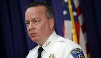 In this Tuesday, April 4, 2017, file photo, Baltimore Police Department Commissioner Kevin Davis speaks at a news conference at the department's headquarters in Baltimore, in response to the Department of Justice's request for a 90-day delay of a hearing on its proposed overhaul of the police department. (AP Photo/Patrick Semansky, File)