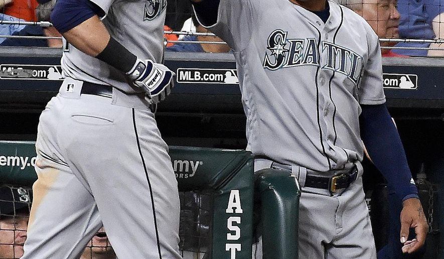 Seattle Mariners' Mitch Haniger, left, celebrates his solo home run off Houston Astros starting pitcher Joe Musgrove with Leonys Martin during the third inning of a baseball game, Thursday, April 6, 2017, in Houston. (AP Photo/Eric Christian Smith)