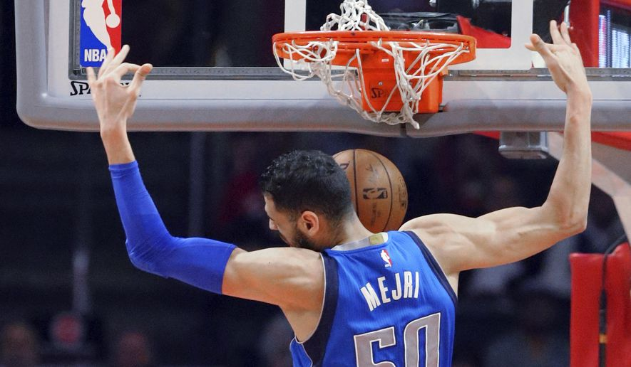 Dallas Mavericks center Salah Mejri dunks against the Los Angeles Clippers during the first half of an NBA basketball game in Los Angeles on Wednesday, April 5, 2017. (AP Photo/Reed Saxon)