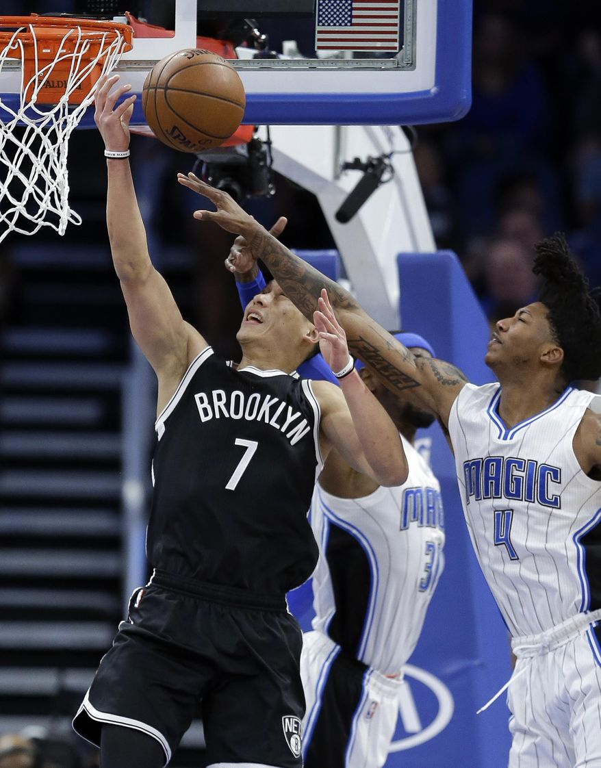 Brooklyn Nets' Jeremy Lin (7) goes up for a shot past Orlando Magic's Elfrid Payton (4) during the first half of an NBA basketball game, Thursday, April 6, 2017, in Orlando, Fla. (AP Photo/John Raoux)