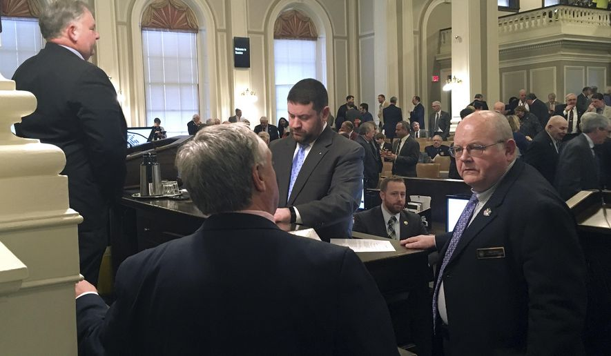 House Majority Leader Dick Hinch, right, confers with House Chief of Staff Terry Pfaff, left, prior to a vote on the House budget on Thursday, April 6, 2017 at the State house in Concord, New Hampshire. The House adjourned 45 minutes later without passing a spending deal. In background are House Speaker Shawn Jasper, left, and House Clerk Paul Smith, center. (AP Photo/Kathleen Ronayne)