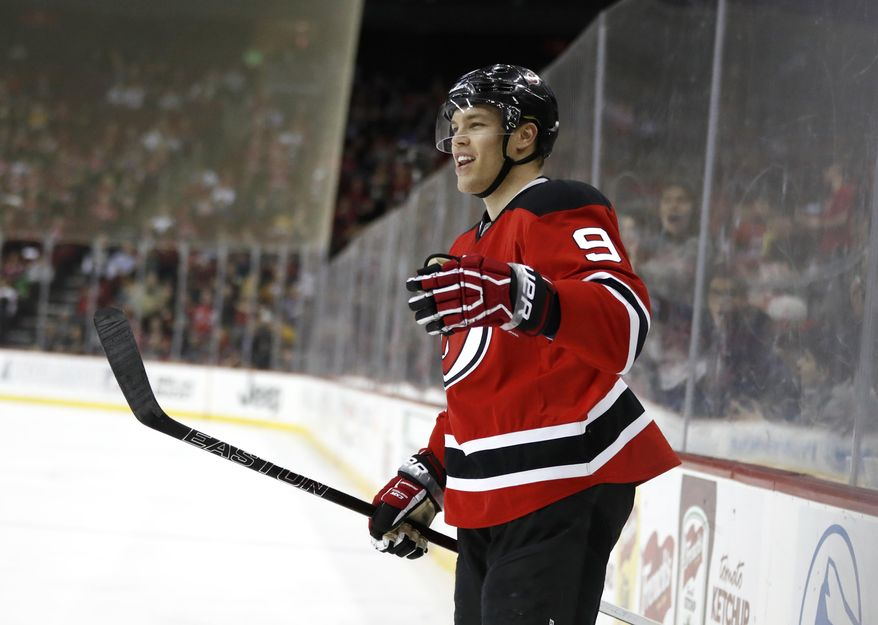 New Jersey Devils left wing Taylor Hall (9) celebrates after scoring a goal on the Pittsburgh Penguins during the second period of an NHL hockey game, Thursday, April 6, 2017, in Newark, N.J. (AP Photo/Julio Cortez)