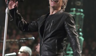 """FILE- In this March 31, 2017, photo, Jon Bon Jovi of the band Bon Jovi performs in concert during their """"This House Is Not for Sale Tour"""" at The Wells Fargo Center in Philadelphia. The New Jersey-born rocker decided Thursday, April 6, to postpone this weekend's concerts as he continues to recover from bronchitis. (Photo by Owen Sweeney/Invision/AP, File)"""