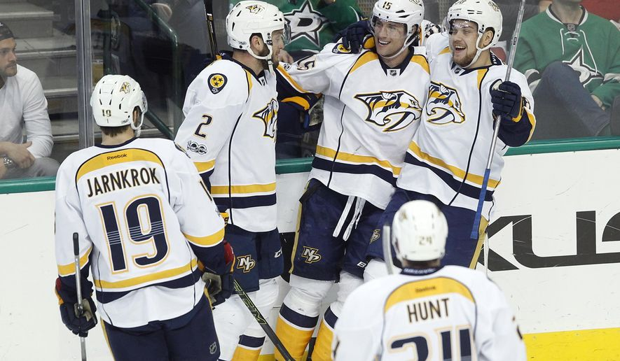 Nashville Predators right wing Craig Smith (15) is congratulated by team members after scoring against Dallas Stars goalie Antti Niemi during the first period of an NHL hockey game Thursday, April 6, 2017, in Dallas. (AP Photo/Tim Sharp)