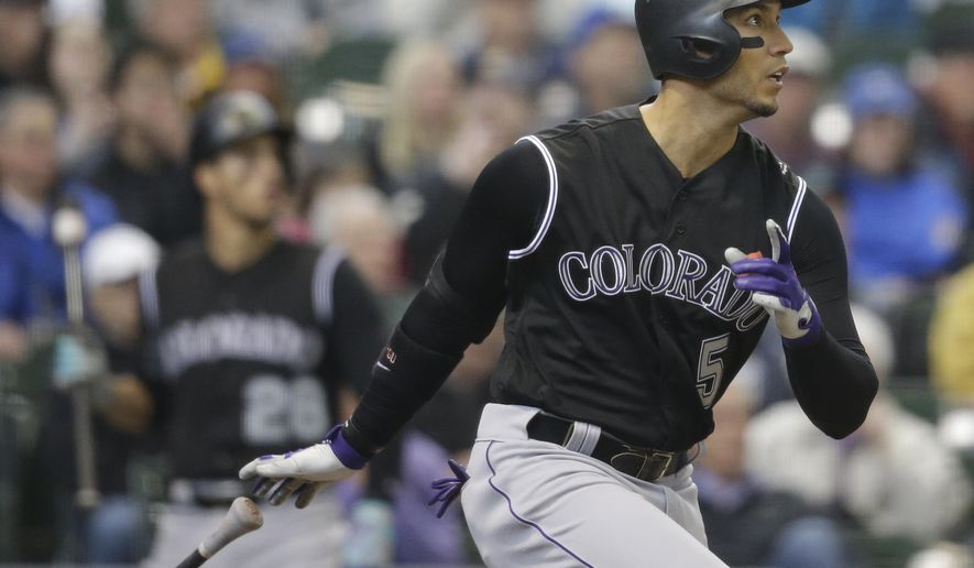 Colorado Rockies' Carlos Gonzalez watches his double against the Milwaukee Brewers during the fourth inning of a baseball game Thursday, April 6, 2017, in Milwaukee. (AP Photo/Jeffrey Phelps)