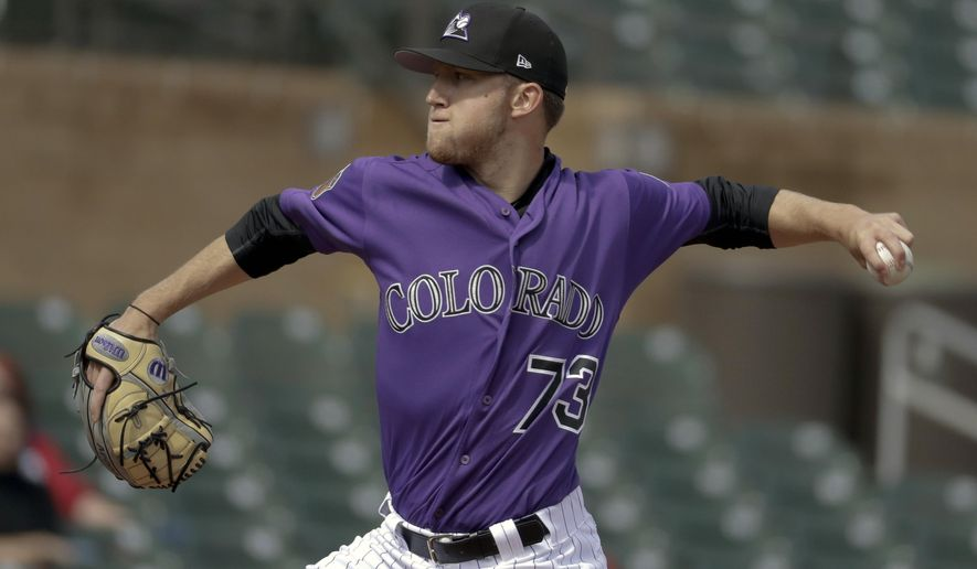 FILE - In this Feb. 28, 2017, file photo, Colorado Rockies starting pitcher Kyle Freeland throws against the Los Angeles Dodgers during the first inning of a spring baseball game, in Scottsdale, Ariz. Freeland never got to skip school and attend opening day as a youngster growing up in Colorado. The rookie 23-year-old left-hander will catch his first Rockies home opener Friday afternoon, April 7, 2017. Actually, he'll pitch in it, taking the mound as the Rockies host the Los Angeles Dodgers in the opening of a three-game series. (AP Photo/Chris Carlson, File)